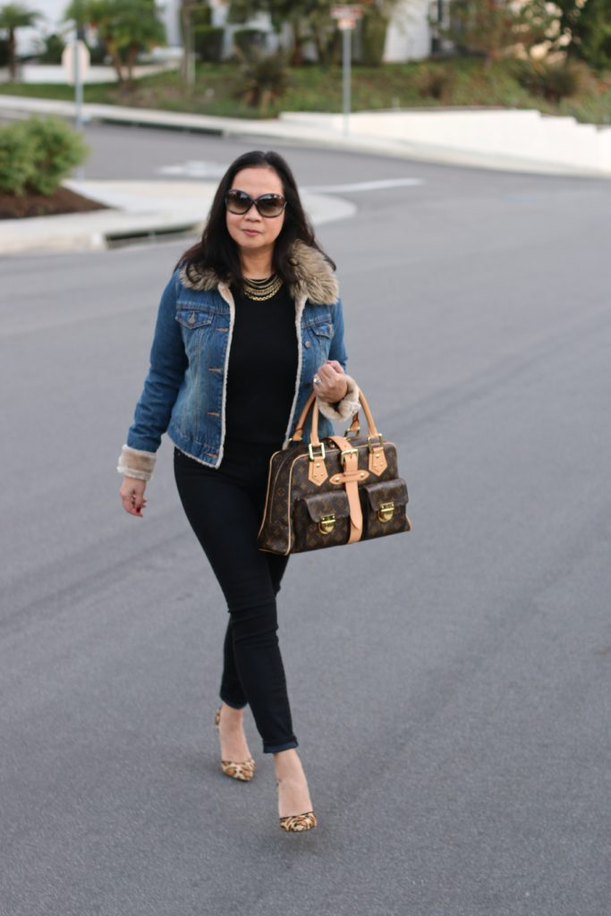Image of a black on black outfit layered with a denim jacket